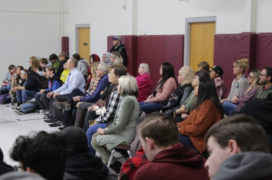 Students, faculty members and visitors listen as Rodney Barker speaks during an assembly Jan. 10, 2020, at Rocinante High School in Farmington.