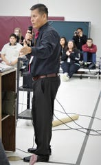 Rocinante HIgh School Principal Peter Deswood addresses students at the beginning of an assembly at the school featuring author Rodney Barker on Jan. 10, 2020.