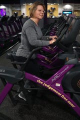 Christine Hoke works out at a Planet Fitness in Wixom on Jan. 10, 2020.