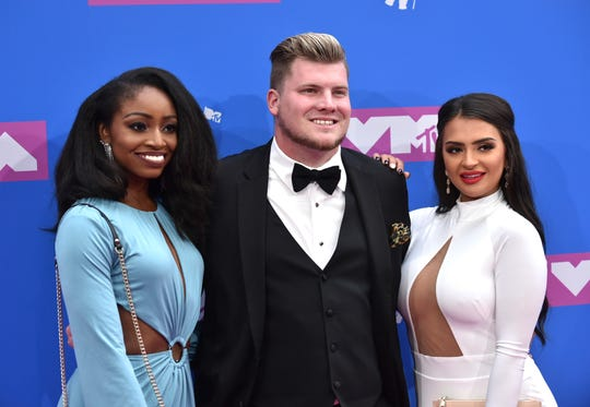 Candace Rice, from left, Codi Butts, and Nilsa Prowant arrive at the MTV Video Music Awards at Radio City Music Hall on Monday, Aug. 20, 2018, in New York.