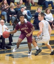 Calvin McCreary (5) and Pensacola High have earned the No. 1 seed in the District 1-4A tournament.