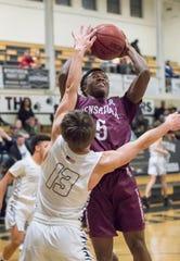 Calvin McCreary (5) shoots during the Pensacola vs Milton basketball game at Milton High School on Thursday, Jan. 9, 2019.