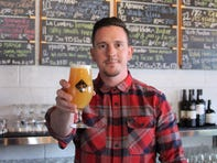 Justin Evans pours an IPA at The Theodore, his newest beer bar and bottle shop on Roosevelt Row. He also owns The Wandering Tortoise, The Sleepy Whale and The Golden Pineapple, soon to open in Tempe.