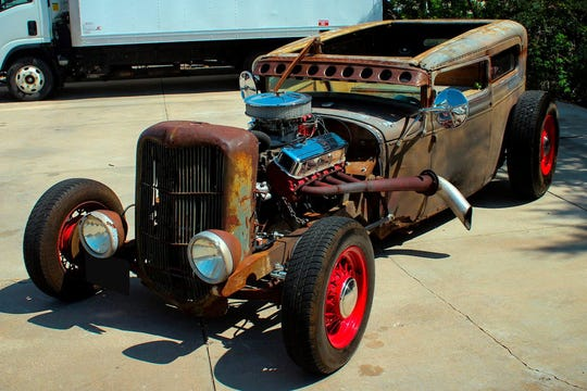 The 1929 Ford Model A coupe comes with an air-ride suspension, custom wood interior, a custom grim reaper sickle axe parking brake and a set of spoke wheels.