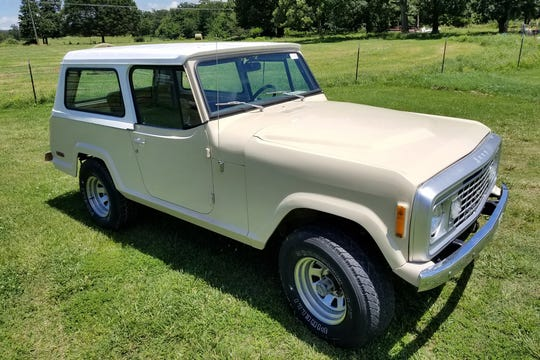 This 4x4 1973 Jeep Commando features a half cab and a full hardtop with new paint and interior. It features a half cab and a full hardtop.