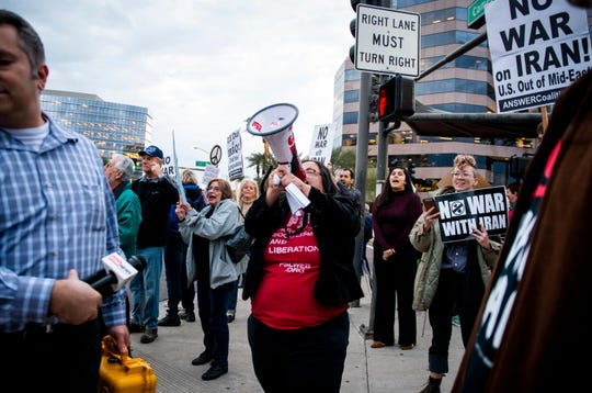 Party for Socialism and Liberation organizer Christina Green leads anti-war chants at a protest on the corner of Camelback Road and 24th Street in Phoenix on Thursday, Jan. 9, 2020.
