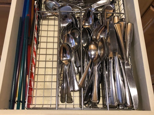 I opened the silverware drawer, but there were no forks.