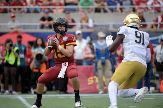 Iowa State quarterback Brock Purdy (15) sets up to throw a pass in front of Notre Dame defensive lineman Adetokunbo Ogundeji (91) during the first half of the Camping World Bowl NCAA college football game Saturday, Dec. 28, 2019, in Orlando, Fla. (AP Photo/Phelan M. Ebenhack)