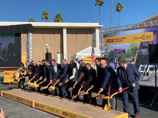 Mesa and ASU leaders ceremonially turn dirt at the ASU building groundbreaking ceremony in downtown Mesa on Jan. 10.
