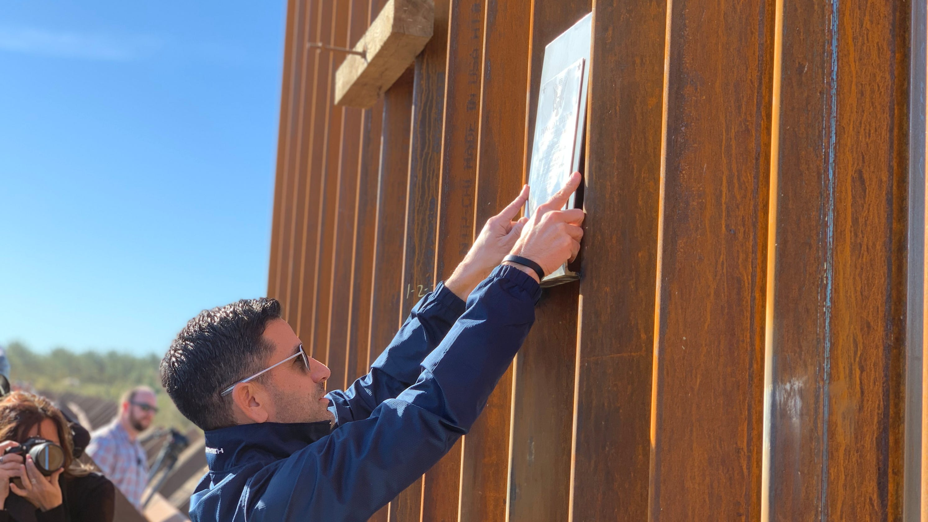 Homeland Security chief marks completion of 100 miles of 'new border wall' with plaque