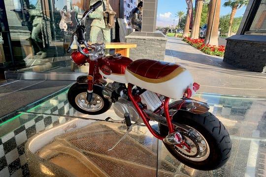 The first car to kick off the auction isn't actually a car, but a custom Honda mini-bike.