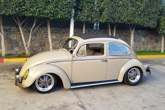 This custom 1958 Volkswagen Beetle has been restored and features new custom Klassik Rader wheels and atweed interior brings it all together.