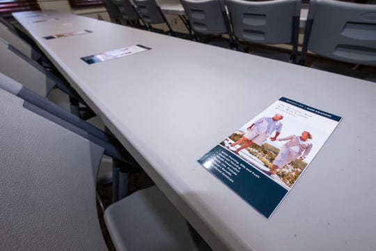 Pamphlets are set out on tables ahead of a workshop at Simasko Law's new Kimball Township office.