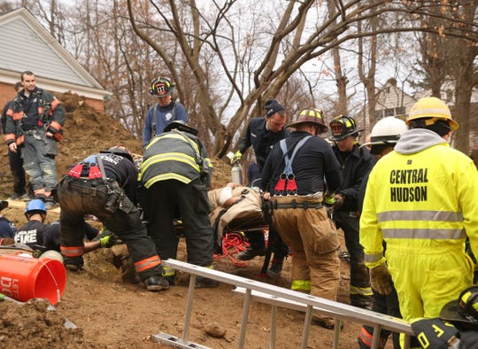 One of two trapped workers is removed from a collapsed trench in the City of Poughkeepsie on January 10, 2020.