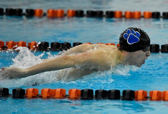 Dallastown's Justin Smick blazes ahead of Central's Clayton Bosend, not shown, during the butterfly stage of the boy's 200 individual medley, Thursday, January 9, 2020.John A. Pavoncello photo