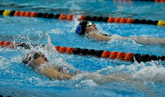 Ava Gemma of Central York, left, catches Zoe Schneider of Dallastown in the backstroke leg of the 200 yard individual medley, Thursday, January 9, 2020.John A. Pavoncello photo