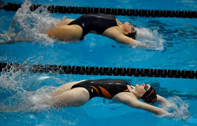 Gabby Miller of Central York and Langley Brockway of Dallastown come off the wall at the start of the girl's 200 yard medley relay, Thursday, January 9, 2020.
