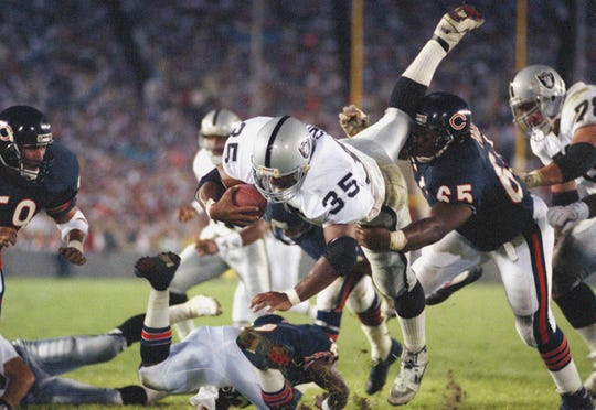 Los Angeles Raiders running back Steve Smith (35) flies over the goal line for a fourth quarter touchdown in Chicago, Aug. 24, 1990. (AP Photo/John Swart)