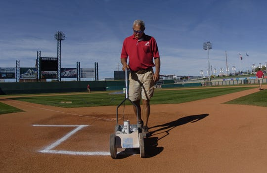 Rob Hastings works on the grounds crew for the Reno Aces.