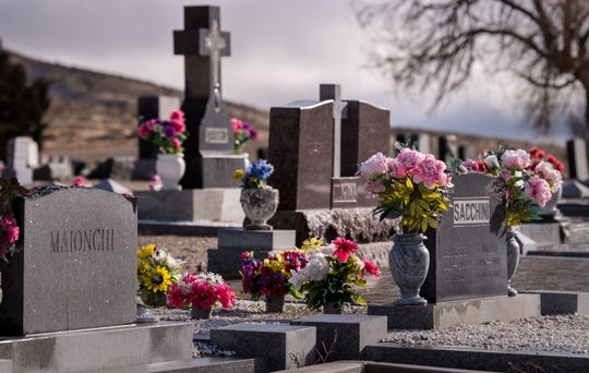 Flowers adorn gravestones at the Valley View Cemetery in Yerington.