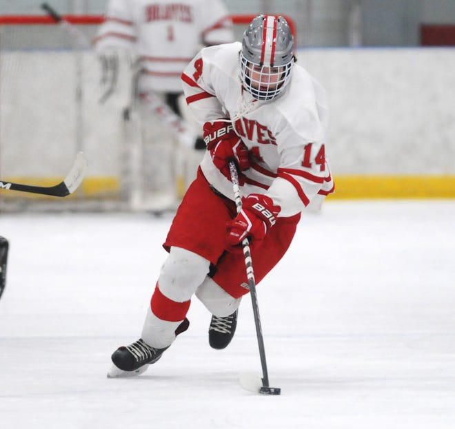 Carter McWilliams of Canandaigua brings the puck up ice for the Braves during a game against Notre Dame of Batavia last week. McWilliams is the leading scorer in Braves' history.
