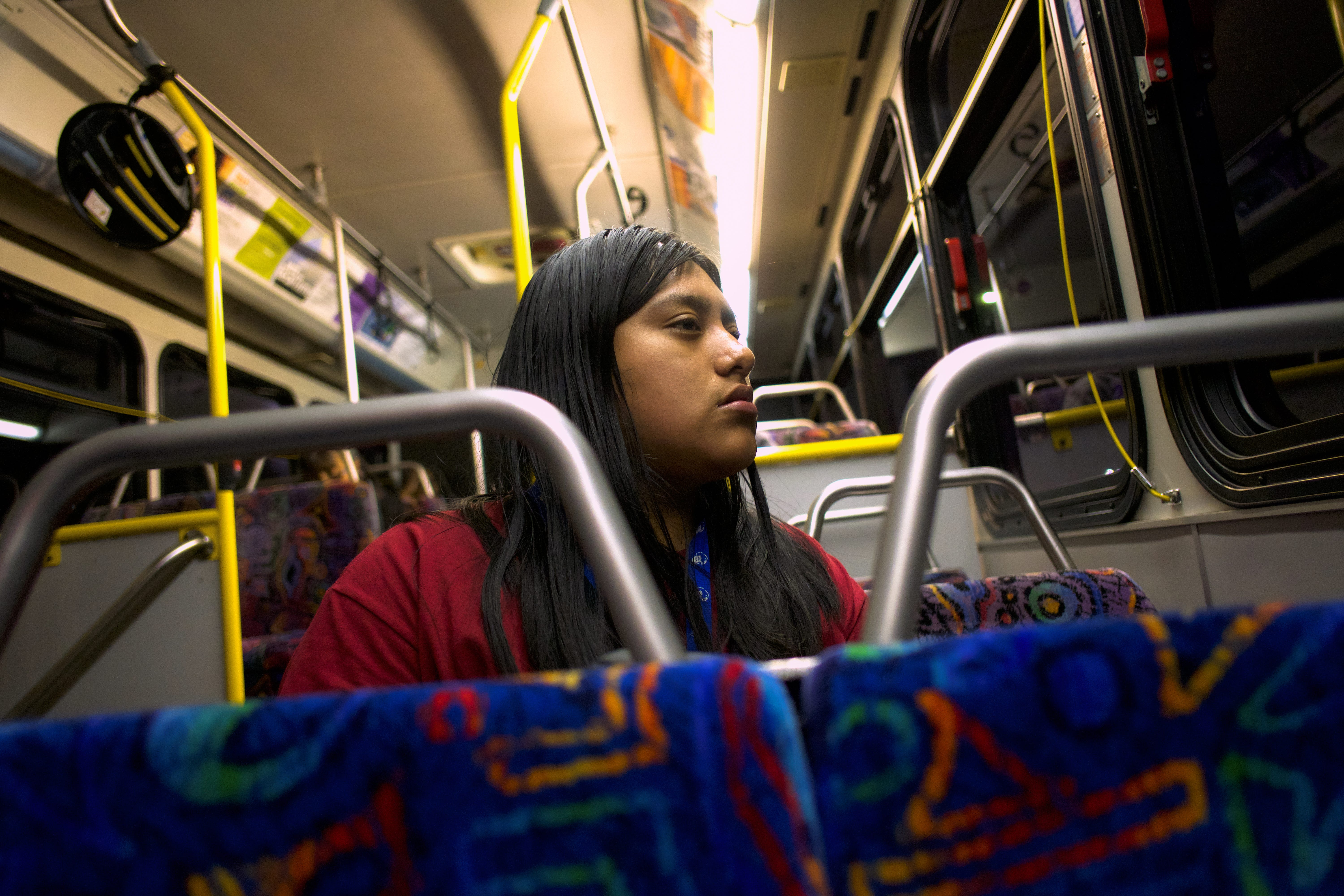 Resi Salvador takes a 40-minute bus ride from CSU Monterey Bay in Seaside, where she goes to school, to her parents' home in Salinas.