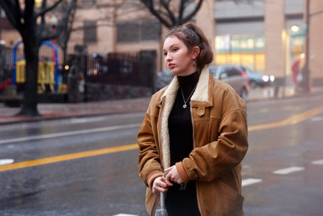 In this Dec. 30, 2019, photo, Shoshana Blum, a 20-year-old junior at City College of New York, waits for a taxi in New York. Despite having been victim to a verbal and physical anti-Semitic attack on the subway, Blum wears her Star of David pendant, a visible marker of her Jewish identity, proudly.