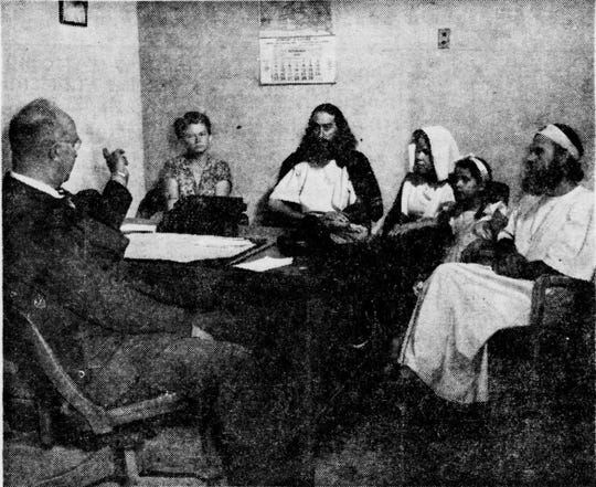 The image is of Krishna Venta (center) and his entourage being questioned by Sioux Falls Detective Oliver Crabbs. From left to right Frances Eno, a secretary, Venta, wife Ruth, daughter Nikki, brother Paul (a moniker for Martin Baker).