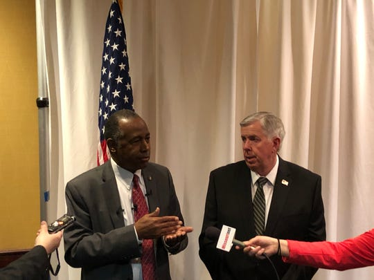 Housing Secretary Ben Carson, left, speaks with reporters at a news conference following the Governor's Prayer Breakfast on Thursday, Jan. 10, 2020.