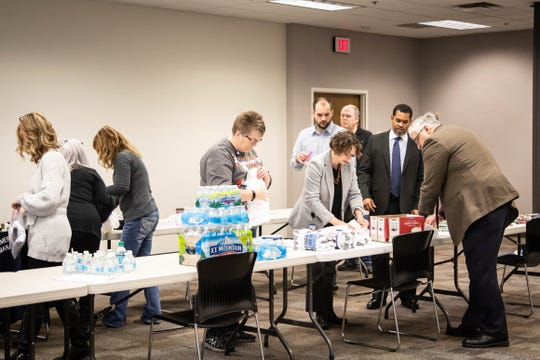 Department of Public Safety employees assemble kits to be handed out to people experiencing homelessness.