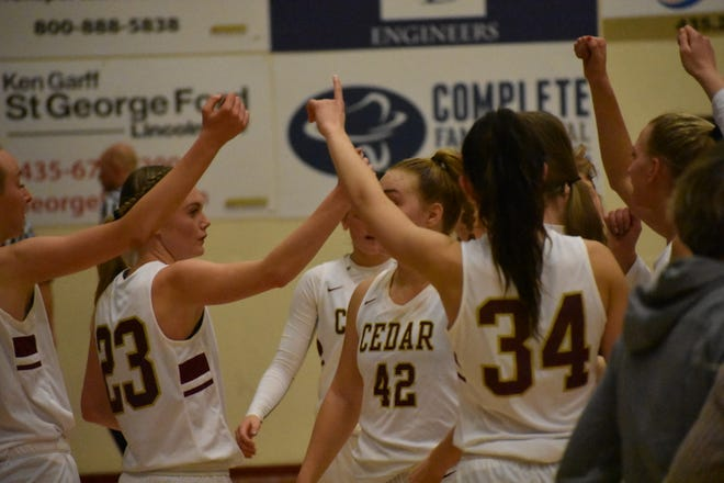 Cedar celebrates beating Desert Hills 53-48 Wednesday night.