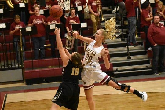 Cedar's Japrix Weaver swats Desert Hills' Maggie Westhoff's shot late in the game.