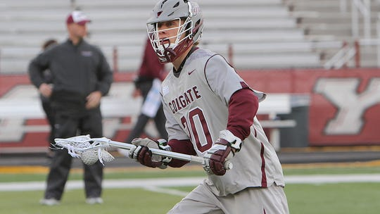 Colgate University senior attacker Lewis Langford, a former Maclay School star, warms up before a game last season.