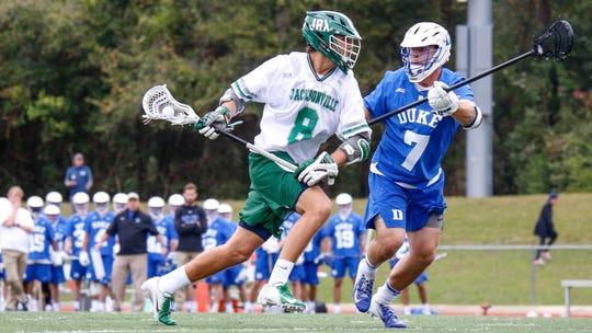 Jacksonville University lacrosse attacker Eric Applegate makes a move towards goal during a game against Duke last season.