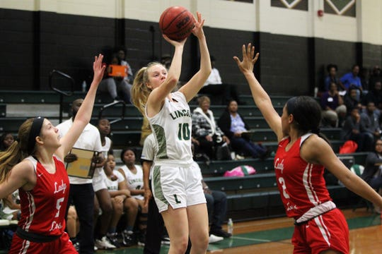 Lincoln sophomore Baylee Smith shoots a contested jumper as Lincoln beat Leon 58-47 on Jan. 9, 2020.