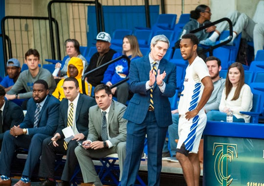TCC men's basketball head coach Zach Settembre goes over strategy with Yahel Hill,
