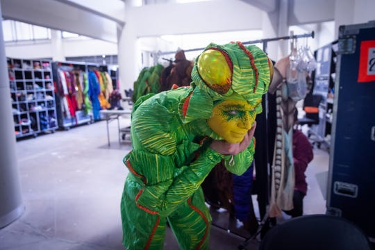 Kilian Mongey, one of Cirque du Soleil's OVO tumblers, gets dressed for a performance.