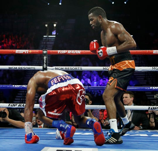 Jesse Hart knocks down Sullivan Barrera during a light heavyweight boxing match Saturday, June 15, 2019, in Las Vegas.