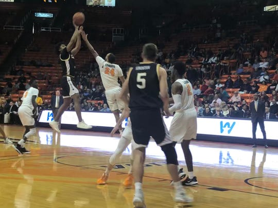 Southern Miss' Gabe Watson tries to shoot over the defense of UTEP's Jordan Lathon on Thursday night, Jan. 9, 2020, at the Don Haskins Center.