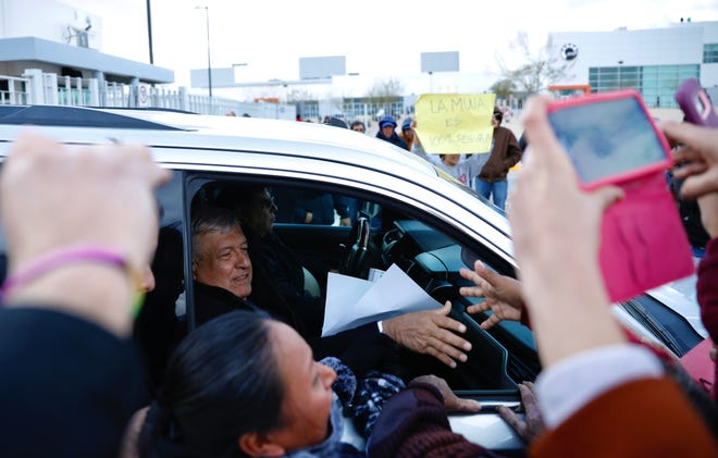 Mexican President Andrés Manuel López Obrador shakes hands and speaks with supporters and protesters after a meeting at a factory in Juárez on Friday, Jan. 10, 2020.
