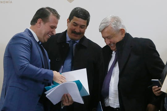 Luis Aguirre Lang, president of Mexico's industrial association, INDEX, from left, Chihuahua Gov. Javier Corral and Mexican President Andrés Manuel López Obrador smile at an event with more than 500 business leaders at a maquiladora assembly factory Friday, Jan. 10, 2020, in Juárez.