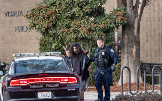 Visalia Police detain a man at the Visalia Public Library on Thursday, January 9, 2020. Police responded to a report of a man that touched a child inside the library.