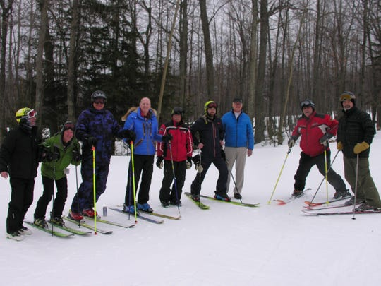 Tom Riordan celebrated his 60th anniversary of downhill skiing by, with the help of friends, recreating the photo published in the newspaper back then. He's the guy in the blue jacket, fourth from the left.