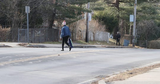 A woman crosses West Eckerson Road in Hillcrest on Jan. 10, 2020. Suzanne Noel of Spring Valley was hit and killed by a driver there in January 2019.