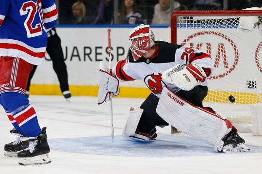 Jan 9, 2020; New York, New York, USA; New York Rangers defenseman Tony DeAngelo (not pictured) scores a goal past New Jersey Devils goaltender Mackenzie Blackwood (29) for a hat trick during the second period at Madison Square Garden. Mandatory Credit: Noah K. Murray-USA TODAY Sports