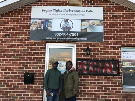 Edward Harrison and his son Junior in front of their barbershop Pryme Styles Babershop and Cafe. The pair say the continued road closure for a Delaware River and Bay Authority project on the street has negatively impacted their business.