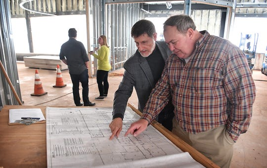 Dr. Jerry Meadows, left, Chief Education Officer for Christ Academy, and Trevor Edwards look over the floorplans for the new Blended Learning Center expansion at the school Friday.