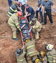 Wichita Falls firefighters responded to reports of two trapped construction workers Friday morning, rescuing the two after a ditch they were working in reportedly collapsed upon them.