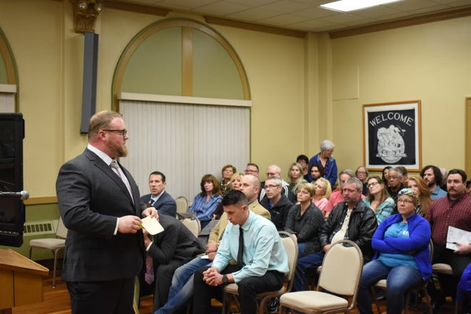 Jarrett Barnhouse of Cairn Recovery addresses the crowd at the recent Board of Zoning Appeals meeting after requesting to table a request to open recovery housing in the Putnam neighborhood. He apologized to the crowd for delaying discussion on the request.