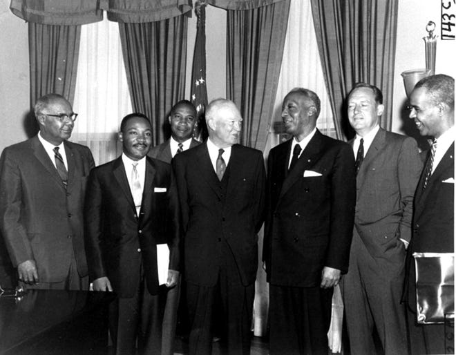 "President Eisenhower poses in his office with black leaders with whom he discussed civil rights issues, including E. Frederic Morrow, rear, Martin Luther King, Jr., A. Philip Randolph, third from right, and Roy Wilkins, right, on June 23, 1958. Eisenhower was told that court ordered suspension of school integration at Little Rock, Arkansas ""has shocked and outraged black citizens and millions of their fellow Americans."""